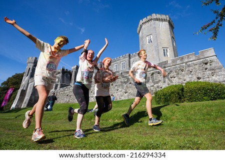 LOUGH CUTRA, GORT, IRELAND - SEPTEMBER 6: Unidentified people runing through the course during annual RUN OR DYE, the World's Most Coloful 5K, on September 6, 2014 in Lough Cutra, Gort, Ireland. - stock photo