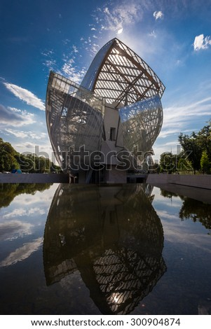 Louis Vuitton Foundation PARIS, FRANCE - June 18, 2015: building. Made of 3,584 laminated glass panels, it was designed by the architect Frank Gehry and opened to the public in 2014. - stock photo