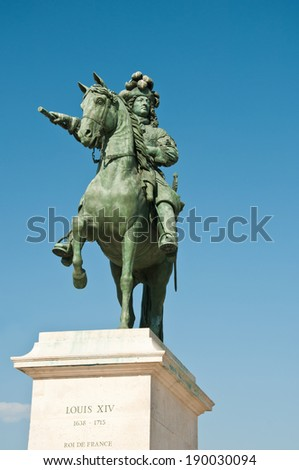 Louis XIV statue in Versailles - stock photo