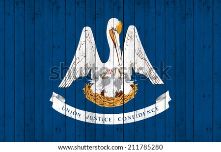 Louisiana flag with wood background - stock photo