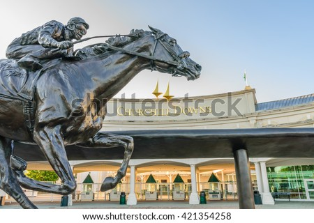 LOUISVILLE, KENTUCKY, USA - MAY 15 2016:   Entrance to Churchill Downs featuring a statue of 2006 Kentucky Derby Champion Barbaro. - stock photo
