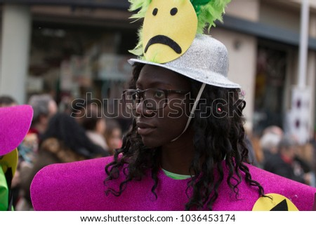 LOULE, PORTUGAL - FEB 2018: Colorful Carnival (Carnaval) Parade festival participants on Loule city, Portugal.