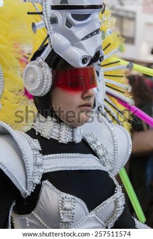 LOULE, PORTUGAL - FEB 2015: Colorful Carnival (Carnaval) Parade festival participants on Loule city, Portugal. - stock photo