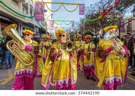 LOULE, PORTUGAL - February 2016: Cheerful carnival parade in the city of Loule, Algarve, Portugal. Participants cheer people. - stock photo