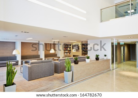 Lounge and library at modern business center - stock photo