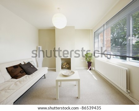 lounge area in newly restored rebuilt house - stock photo