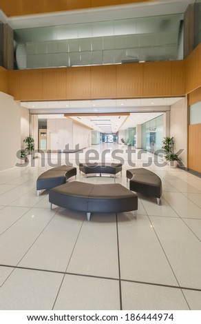 Lounge area. Modern lobby, hallway  of the five stars luxury hotel, business center in Vancouver, Canada. Interior design. Vertical.