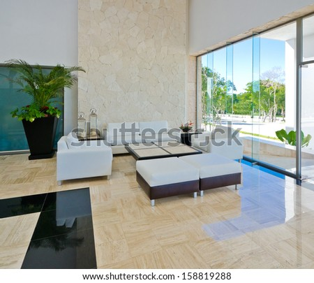 Lounge area of a hotel, club, company lobby. Fragment of the modern lobby of the five stars hotel in Mexico. Interior design. - stock photo