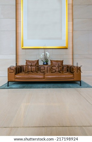 Lounge area of a hotel, club, company lobby. Fragment of the modern lobby of the  hotel.  Interior design. Vertical. - stock photo