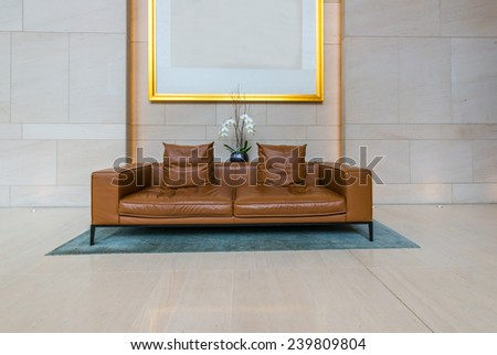 Lounge area of a hotel, club, company lobby. Fragment of the modern lobby of the  hotel.  Interior design. - stock photo