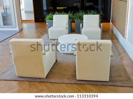 Lounge area of a hotel. Fragment of the modern lobby of the five stars hotel. Interior design.
