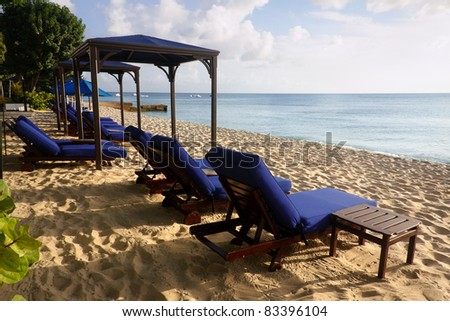 Lounge Chair at Paynes Bay beach in Barbados - stock photo