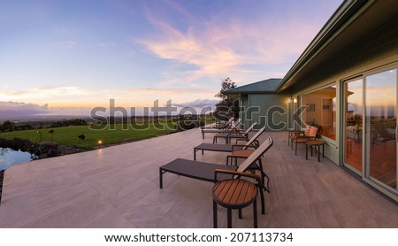 Lounge chairs on deck at sunset  - stock photo