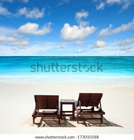 Lounge chairs on remote tropical beach