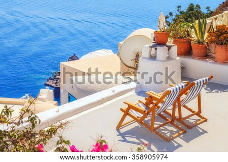 Lounge chairs with a view of the caldera, Oia village, Santorini, Greece
