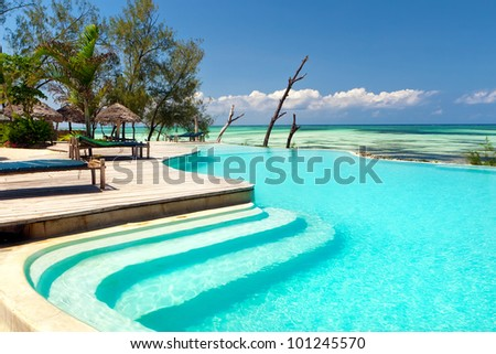 Lounge near inifinity pool, Zanzibar - stock photo