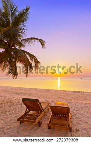 Loungers on Maldives beach - nature vacation background - stock photo
