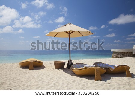 loungers on the beach in the Maldives - stock photo