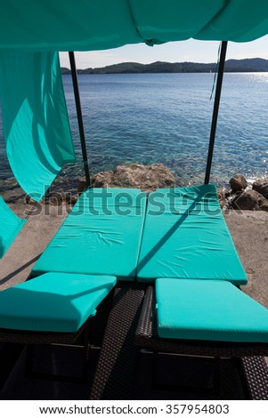 loungers with baldachin and sea view