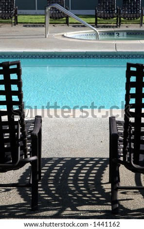Lounging by the pool. - stock photo