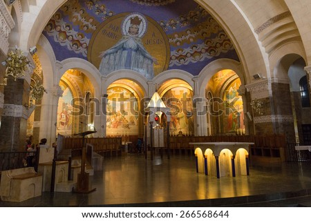 LOURDES, FRANCE - JULY 23, 2014: Chapel  inside the Rosary Basilica in Lourdes displaying Christian murals. - stock photo