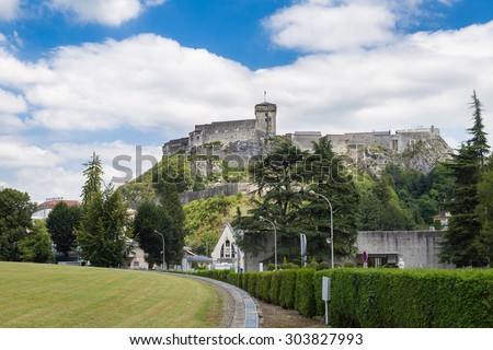 LOURDES, FRANCE - JULY 23, 2014: The chateau fort de Lourdes is a historic castle located in Lourdes in the Hautes-Pyrenees departement of France. Musee Pyreneen is located in the fort.