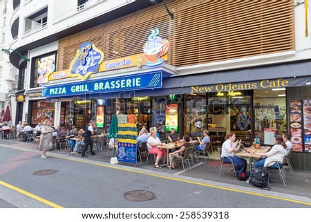 LOURDES, FRANCE - JULY 23, 2014: Tourists and locals enjoying refreshements in one of the many establishments in Lourdes, France. Lourdes has about 270 hotels. - stock photo