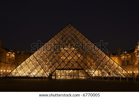 Louvre pyramid at night - stock photo