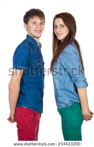 Love a wonderful feeling! Beautiful, young, tender, loving couple, standing opposite each other face to face on a white background - stock photo