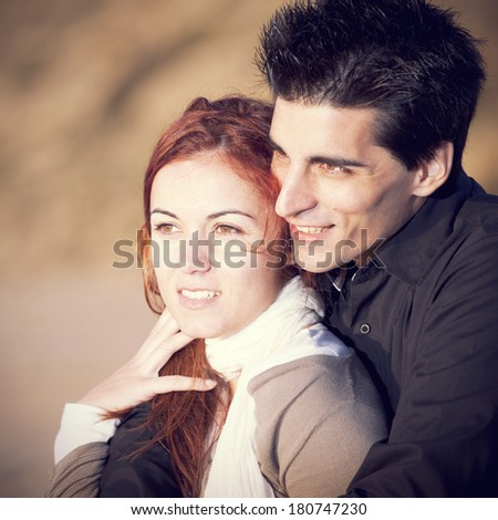 Love and affection between a young couple in outdoor - stock photo