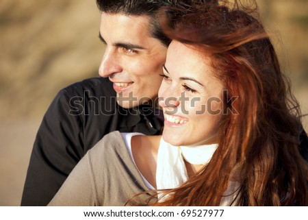 Love and affection between a young couple in outdoor (selective focus with shallow DOF)