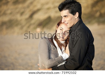 Love and affection between a young couple in outdoor (selective focus with shallow DOF) - stock photo