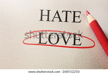 Love and Hate red circle with pencil on textured paper                                - stock photo
