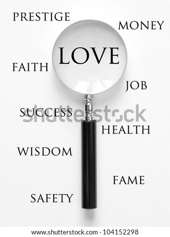 love and magnifying glass - stock photo