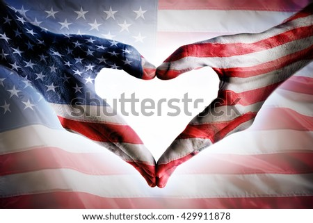 Love And Patriotism - Usa Flag On Heart Shaped Hands  - stock photo