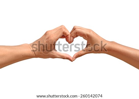 Love and relationships concept - closeup of woman and man hands showing heart shape.