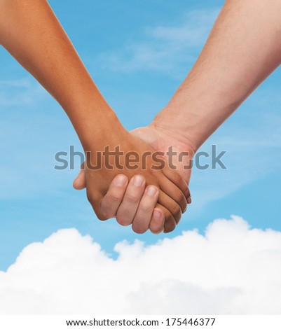 love and relationships concept - closeup of woman and man holding hands