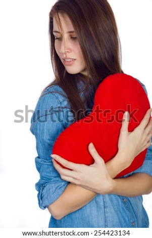 Love and Valentine's Day brunette girl  with  dimples, holding a heart cute and adorable  isolated on white background - stock photo