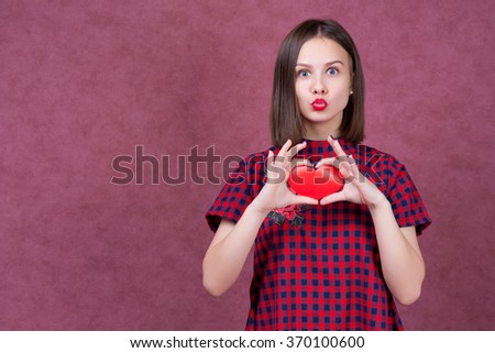 Love and valentines day woman holding heart smiling cute and adorable isolated on pink background.  - stock photo