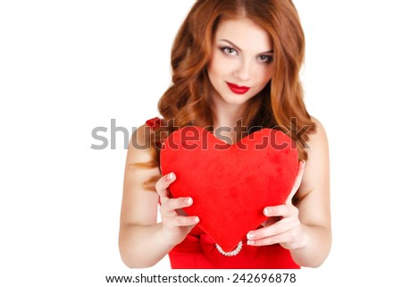Love and valentines day woman holding heart smiling cute and adorable isolated on white background. Beautiful gorgeous woman with glamour bright makeup and red heart. Valentine's Day. - stock photo