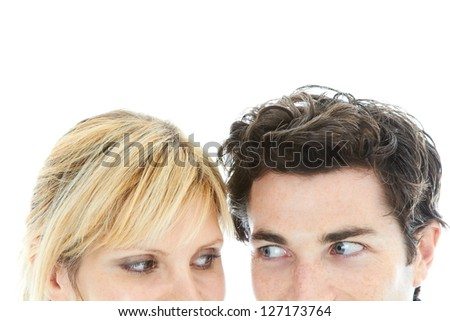 love at first sight isolated on white. male and female looking at each other with lust. candid shot, studio shot isolated on white background. - stock photo