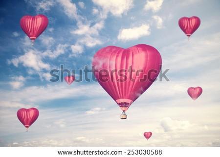 Love balloons, vintage style photo  - stock photo