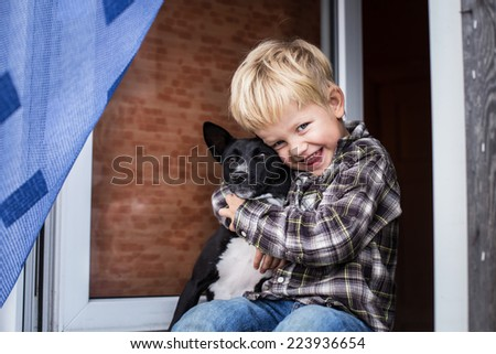 Love between child and his pet. Basenji. Outdoor portrait    - stock photo