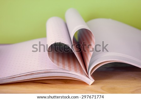 Love book with heart shape green background - stock photo