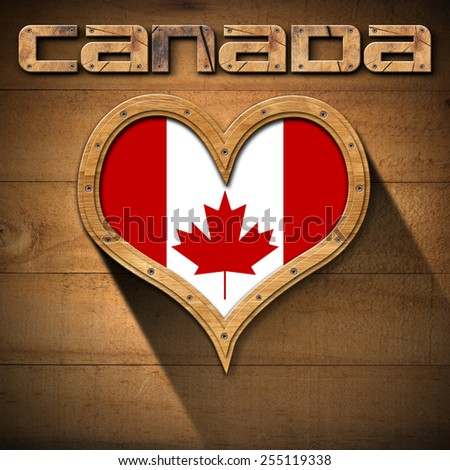 Love Canada. Wooden frame in the shape of heart with Canadian flag interior. On wooden wall with wooden text Canada - stock photo
