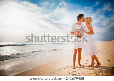 love concept at the beach with beautiful couple background