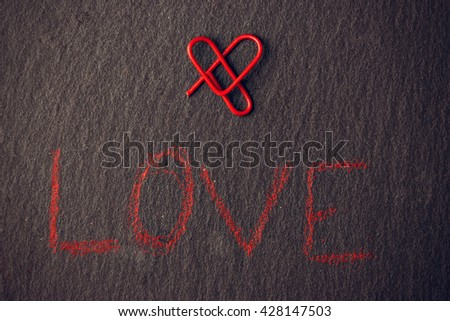 Love concept for lovers made with heart-shaped clip. Horizontal image.