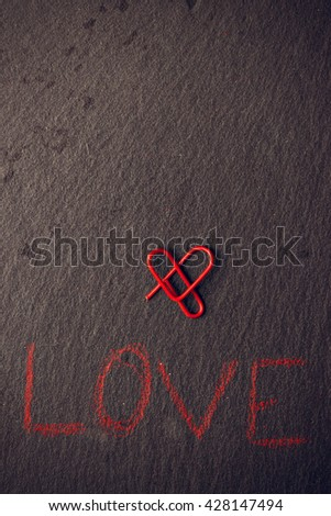 Love concept for lovers made with heart-shaped clip. Vertical image.