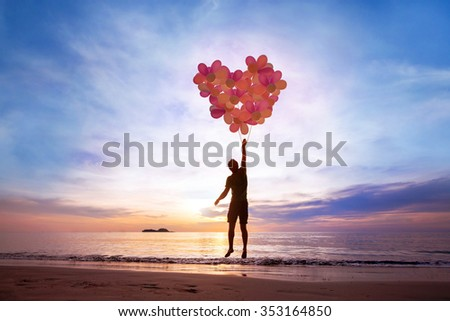 love concept, man flying with heart from balloons, fall in love - stock photo