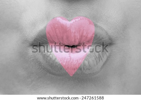 Love concept. Sexy lips with heart shape paint, closeup - stock photo